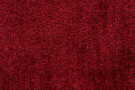 Closeup detail of red fabric texture background. photo