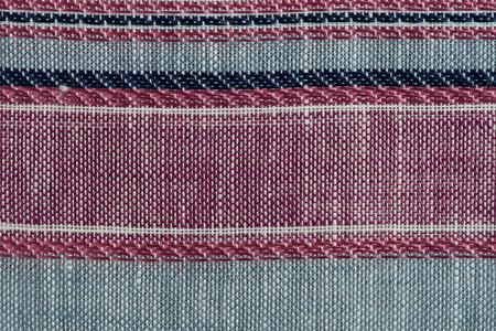 Closeup detail of multi color fabric texture samples. photo