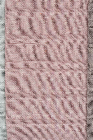 Closeup detail of pink fabric texture background photo