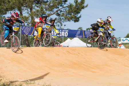off ramp: ESTARREJA, PORTUGAL - MAY 11, 2014: Daniel Matos (731) followed by Ivan Pedrosa (735) during the Taca de Portugal Bmx.