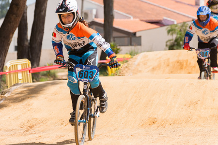 off ramp: ESTARREJA, PORTUGAL - MAY 11, 2014: Marta Guegues (603) leading the race during the Taca de Portugal Bmx. Editorial