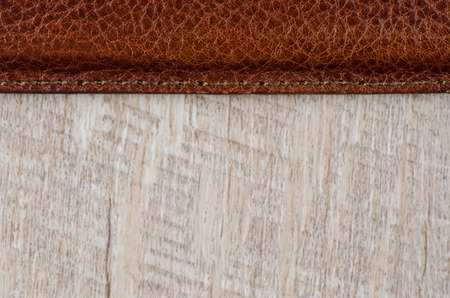suede belt: Leather belt over wooden background.