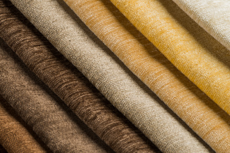 soft textile: Closeup detail of multi color fabric texture samples.