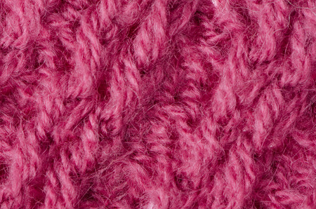 counterpane: Pink knitted wool texture can use as background.