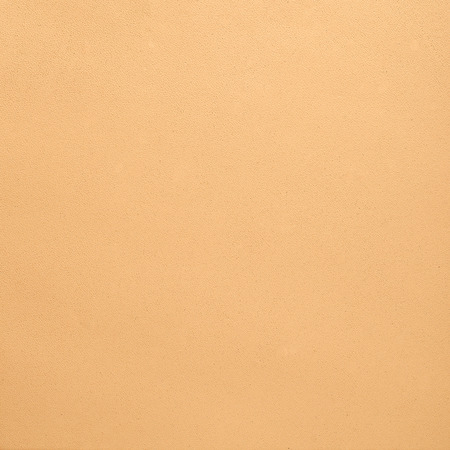 Closeup of beige leather texture background. photo