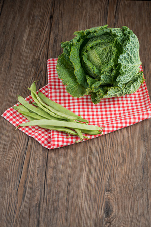 Bunch of freshly picked green beans on a wooden surface. Rustic take. photo