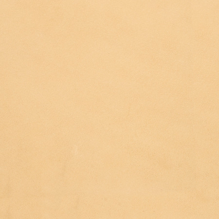 cracklier: Closeup of beige leather texture background.