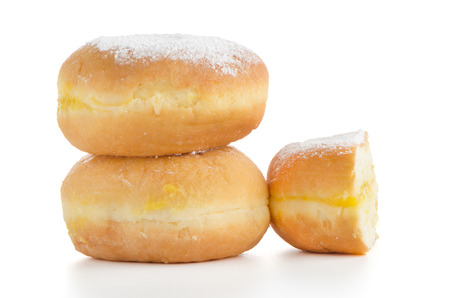 Closeup detail of tasty donuts, isolated on white background. photo