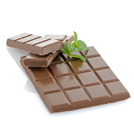 Closeup detail of chocolate and mint leaves on white background. photo