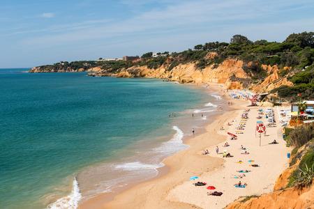 region of algarve: ALBUFEIRA, PORTUGAL - OCTOBER 4, 2014: Olhos de agua beach in Albufeira. This beach is a part of famous tourist region Algarve.