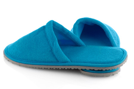houseshoe: A pair of blue slippers on a white background.