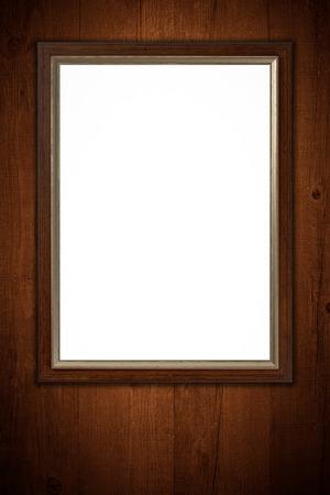 marco madera: Antiguo marco de la imagen en la pared de madera de la vendimia. Foto de archivo