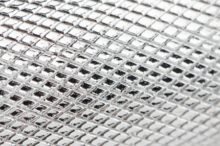penal system: Metal mesh plating isolated against a white background