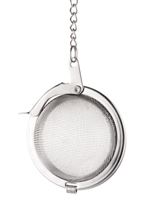 tea strainer: Tea strainer on a white reflective background.
