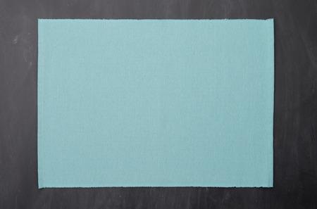 place mat: Place mat on black chalkboard texture. Stock Photo