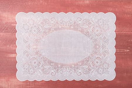 place mat: Retro place mat on wooden deck table.