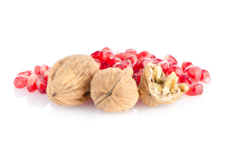 Pomegranate seed pile and nuts isolated on white background. photo