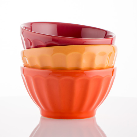 reflective background: Three colored bowls on white reflective background