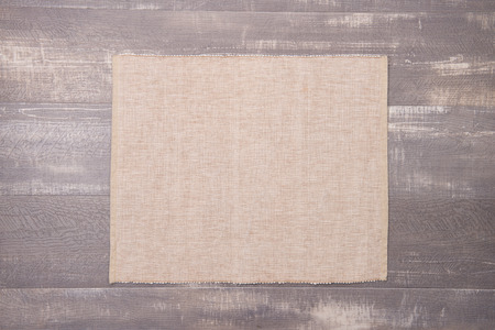 place mat: Place mat on wooden deck table.