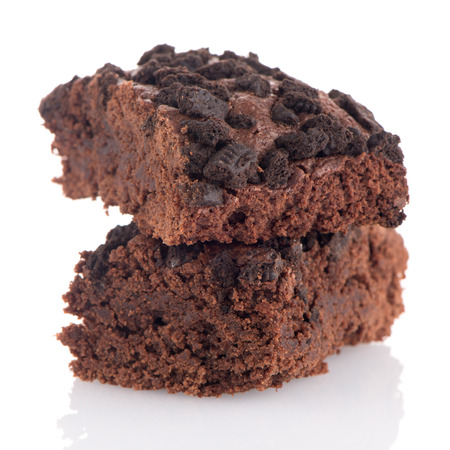 reflective background: Chocolate brownie cake on white reflective background.