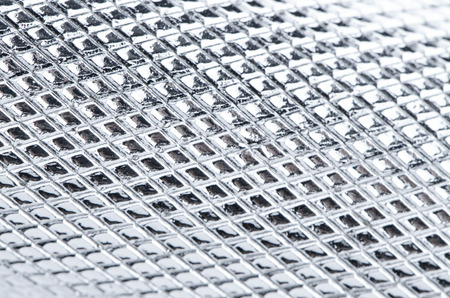 plating: Metal mesh plating isolated against a white background