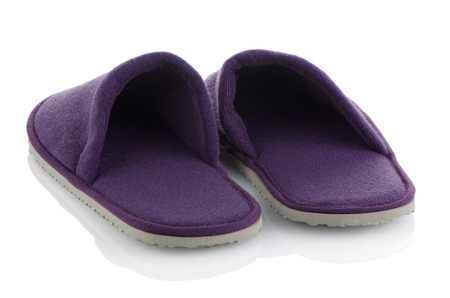 terrycloth: A pair of purple slippers on a white background.
