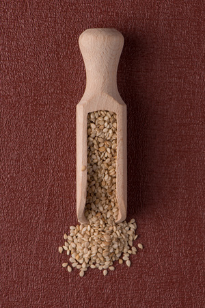 sesame seeds: Top view of sesame seeds against red vinyl background. Stock Photo