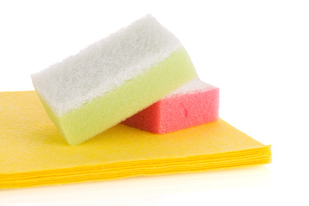 cleaning background: Cleaning equipment, sponges and cloth on a white background. Stock Photo