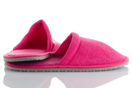 terrycloth: A pair of pink slippers on a white background.