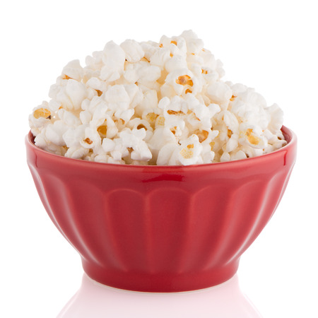 popcorn bowls: Popcorn in a red bowl on a white background