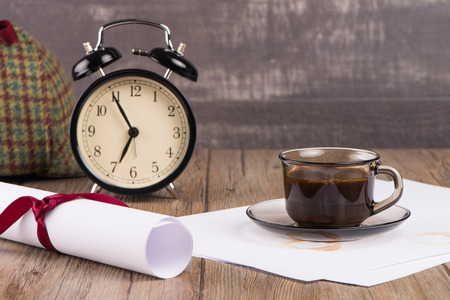 animal private: Old clock, hat, coffee and paper sheets on old Wooden table.