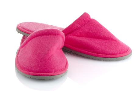 houseshoe: A pair of pink slippers on a white background.
