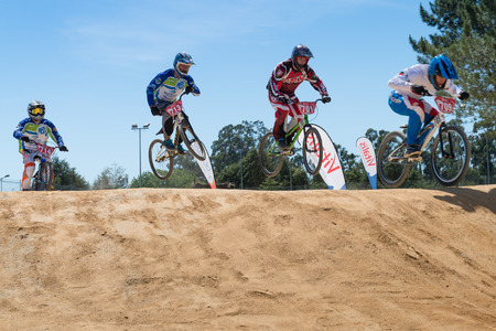 off ramp: ESTARREJA, PORTUGAL - MAY 16, 2015: Cruiser riders jumping during the Taca de Portugal Bmx. Editorial