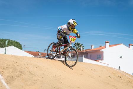 off ramp: ESTARREJA, PORTUGAL - MAY 16, 2015: Ivan Pedrosa focusing on the next jump during the Taca de Portugal Bmx.