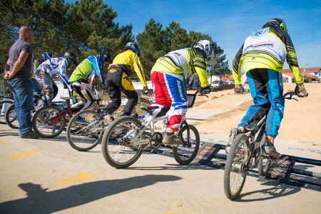 off ramp: ESTARREJA, PORTUGAL - MAY 16, 2015: Juvelines racing start during the Taca de Portugal Bmx. Editorial