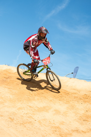off ramp: ESTARREJA, PORTUGAL - MAY 16, 2015: Pedro Ferreira turning during the Taca de Portugal Bmx.
