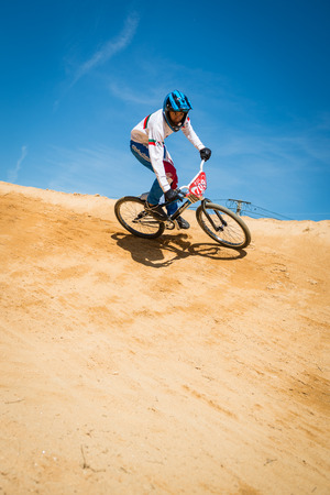 off ramp: ESTARREJA, PORTUGAL - MAY 16, 2015: Miguel Domingos turning during the Taca de Portugal Bmx.