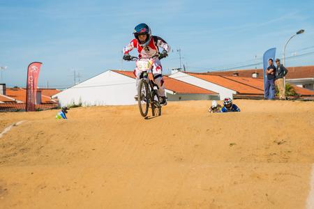 off ramp: ESTARREJA, PORTUGAL - MAY 16, 2015: Andre Ribeiro leading the race during the Taca de Portugal Bmx.