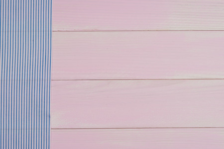 table surface: Blue striped towel over the surface of a wooden table. Stock Photo