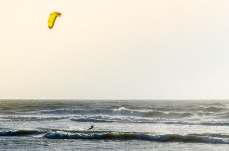 kiter: Kitesurfer on a beautiful background of spray during the sunset. Stock Photo