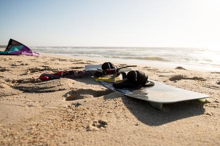 kiter: Kite on the sand beach near the ocean.