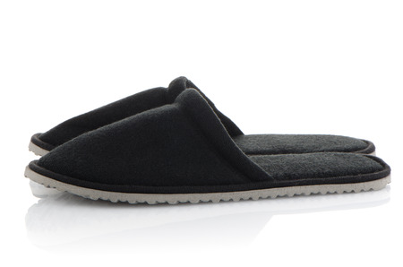 houseshoe: A pair of grey slippers on a white background.