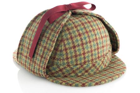 white  hat: British Deerhunter or Sherlock Holmes cap on white background.