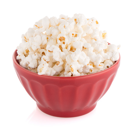 bowls of popcorn: Popcorn in a red bowl on a white background