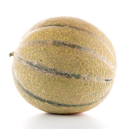 HONEYDEW: Juicy honeydew melon on a white background. Stock Photo