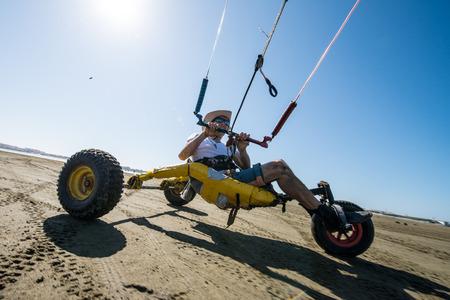 ILHAVO, PORTUGAL - JULY 24, 2015: Ralph Irner riding a kitebuggy during the Festival de Verao na Ria Editorial