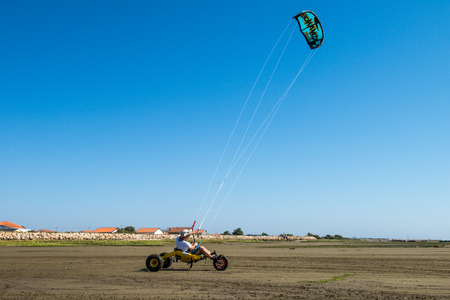 ILHAVO, PORTUGAL - JULY 24, 2015: Ralph Irner riding a kitebuggy during the Festival de Verao na Ria Editorial