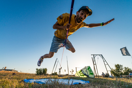 ILHAVO, PORTUGAL - JULY 24, 2015: Andre antunes Slackline performance during the Festival de Verao na Ria Editorial