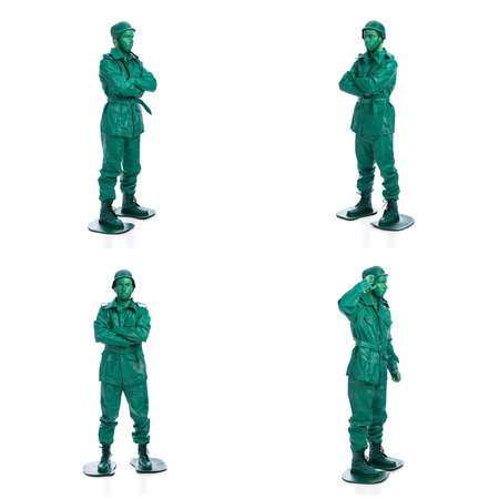 riffle: Four man on a green toy soldier costume standing with riffle isolated on white background.