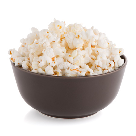 bowls of popcorn: Popcorn in a brown bowl on a white background